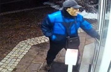 Đeo mặt nạ Obama cướp nhà băng