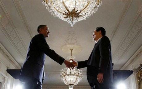 Ông Obama chào đón lãnh đạo Trung Quốc. Ảnh: AP