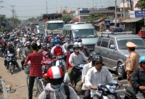 Tái diễn cảnh kẹt xe kinh hoàng ở Tiền Giang vào trưa ngày 8/2 làm cho đường về TP.HCM tiếp tục gian nan./.Ảnh: Thiên Phước