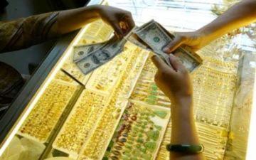 Vàng, đôla tăng vọt
