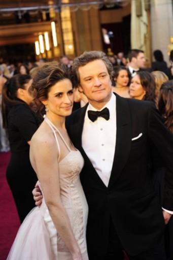 Colin Firth và vợ trên thảm đỏ Oscar. Ảnh: AFP.