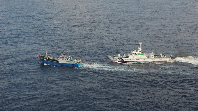 A Chinese fishing boat (L) is pursued by a Japan Coast Guard vessel in waters off Miyako Island, Okinawa prefecture, in this handout  released by 11th Regional Coast Guard Headquarters-Japan Coast Guard February 2, 2013. Japan's coast guard detained the boat near the southern Japanese island of Okinawa on Saturday and arrested the captain for collecting coral illegally, a coast guard official said. The vessel was detained off Miyako Island, some 150 km (95 miles) from islands in the East China Sea known as the Senkaku in Japan and the Diaoyu in China at the centre of a territorial dispute between the two countries, and about 400 km (250 miles) east of Taipei. Mandatory Credit  REUTERS/11th Regional Coast Guard Headquarters-Japan Coast Guard/Handout (JAPAN - Tags: POLITICS TPX IMAGES OF THE DAY)  FOR EDITORIAL USE ONLY. NOT FOR SALE FOR MARKETING OR ADVERTISING CAMPAIGNS. THIS IMAGE HAS BEEN SUPPLIED BY A THIRD PARTY. IT IS DISTRIBUTED, EXACTLY AS RECEIVED BY REUTERS, AS A SERVICE TO CLIENTS. MANDATORY CREDIT