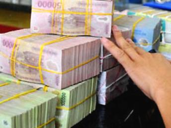 Chậm trễ giải quyết nợ xấu kìm hãm tăng trưởng kinh tế Việt Nam. Reuters