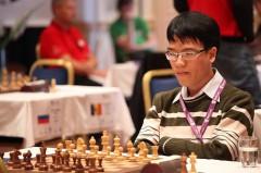 Kỳ thủ Lê Quang Liêm tại World Cup cờ vua thế giới 2013 ở Na Uy - Ảnh: Paul Truong