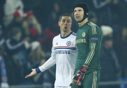 Chelsea's Petr Cech and Fernando Torres chat as they leave the field after loosing to FC Basel in their Champions League Group E soccer match at St. Jakob-Park in Basel