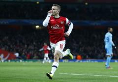 Jack Wilshere lập cú đúp giúp Arsenal đặt một chân vào vòng knock out Champions League - Ảnh: Reuters