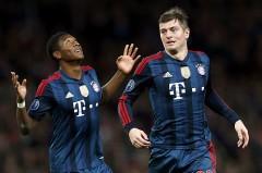 Toni Kroos (phải) ăn mừng bàn thắng vào lưới Arsenal. Ảnh: Reuters