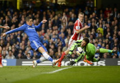 Stoke City's Begovic saves a shot from Chelsea's Torres during their English Premier League soccer match at Stamford Bridge in London