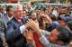 Cựu Tổng thống Mỹ Bill Clinton được hút đám đông khi ông đi trên đường phố tại Hà Nội ngày 6 tháng 12 năm 2006.