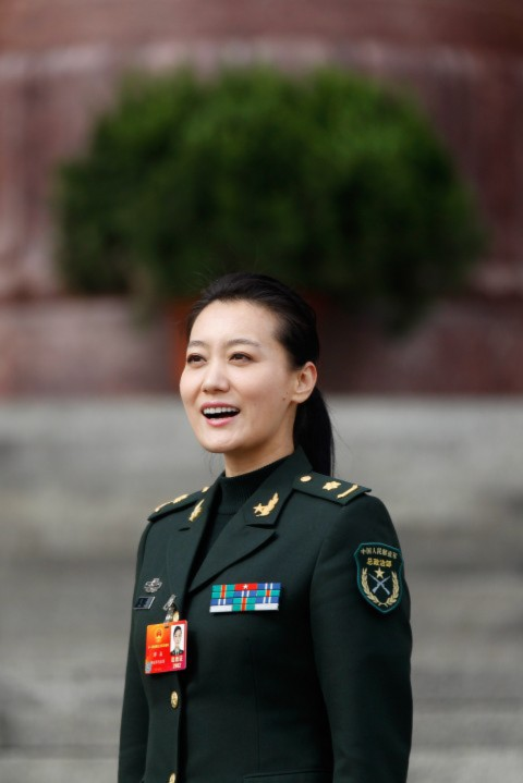 Chinese singer delegate Tan Jing outside The Great Hall Of The People after the second plenary meeting of the National People's Congress (NPC) on March 8, 2012, in Beijing, China. Chinese media said Tan will be absent from the 2015 Chinese New Year Gala.
