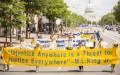Những người theo tập Pháp Luân Công tuần hành kêu gọi chấm dứt cuộc đàn áp ở Trung Quốc hôm 17/7/2014 tại Washington. (Ảnh: Edward Dai/Thời báo Đại Kỷ Nguyên)