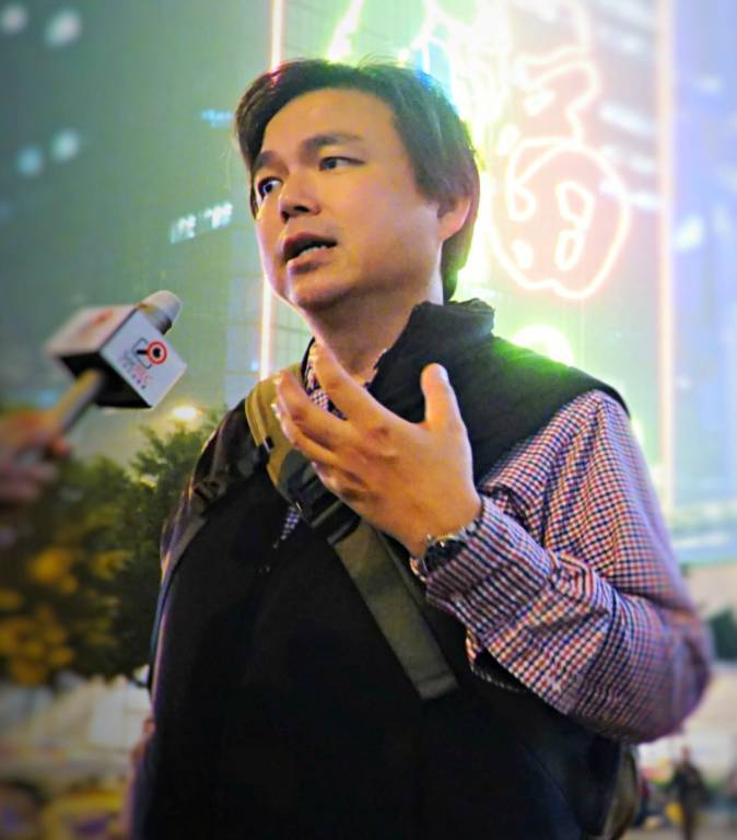 Democracy activist and financier Edward Chin speaks in front of the press in Hong Kong, in this undated photo. He believes big business will leave the country if Beijing keeps disregarding Hong Kong's Basic Law. (Courtesy of Edward Chin)