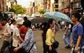 Người qua lại tại khu phố người Hoa ở New York vào ngày 11/7/2014. (Ảnh: Spencer Platt/Getty Images)