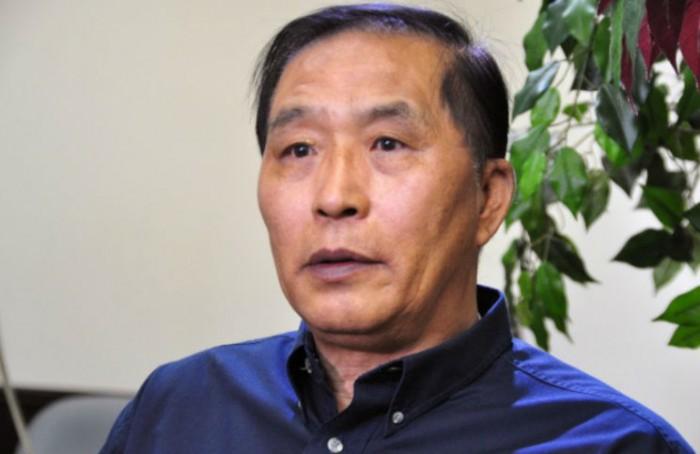 Hàn Quảng Sinh, cựu quan chức ngành tư pháp Thành phố Thẩm Dương, tỉnh Liêu Ninh đông bắc Trung Quốc của Đảng Cộng sản, trả lời phỏng vấn với tờ Epoch Times vào 10/6/2015. (Zhou Xing/Epoch Times)