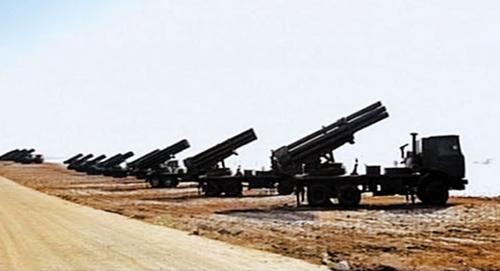 Xe tải có gắn pháo của Triều Tiên xếp hàng trong một cuộc tập trận quân sự năm 2010. Ảnh minh họa: KCTV.