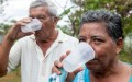 Two people drink water from the water supply system in Bella Vista, Las Lomas, province of Cocle, Panama. Photo: Gerardo Pesantez / World Bank