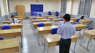 Phòng thi chỉ có 2 thí sinh thi môn sử tại HĐT trường THPT Nguyễn Thị Minh Khai chiều 2-6-2014. Ảnh - Như Hùng/songmoi.vn