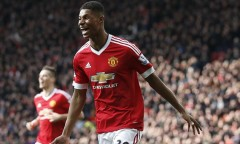 Manchester United's Marcus Rashford, runs to celebrate with teammates after scoring his sides second goal of the game during the English Premier League soccer match between Manchester United and Arsenal at Old Trafford Stadium, Manchester, England, Sunday, Feb. 28, 2016. (AP Photo/Jon Super)