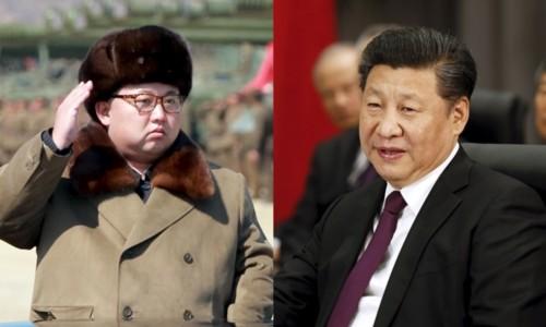 Chủ tịch Trung Quốc Tập Cận Bình (phải) và nhà lãnh đạo Triều Tiên Kim Jong-un. Ảnh: Reuters.