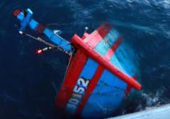 Tàu cá của ngư dân Đà Nẵng bị tàu Trung Quốc đâm chìm hồi tháng 5/2014. Ảnh: Nguyễn Đông.