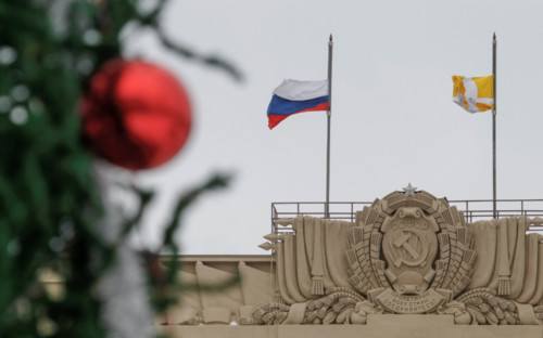 [Caption]National and Stavropol region (R) flags fly at half mast to commemorate passengers and crew members of Russian military plane, which crashed into the Black Sea on its way to Syria, next to a decorated New Year fir tree set in front of at a regional government building in the southern city of Stavropol, Russia, December 26, 2016.