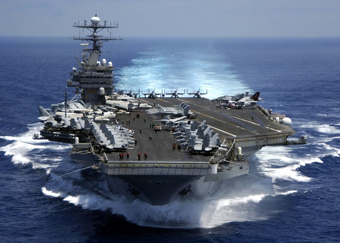 050315-N-3241H-001 	The nuclear powered aircraft carrier USS Carl Vinson (CVN 70) plows through the Indian Ocean as aircraft on its flight deck are prepared for flight operations on March 15, 2005.  The Carl Vinson Strike Group is en route to the Persian Gulf to support for Operation Iraqi Freedom.  DoD photo by Petty Officer 3rd Class Dusty Howell, U.S. Navy.  (Released)