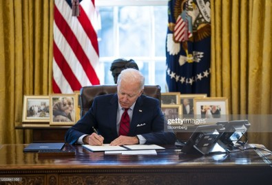 U.S. President Joe Biden signs executive actions in the Oval Office of the White House in Washington, D.C., U.S., on Thursday, Jan. 28, 2021. Biden will make it easier for Americans to buy health insurance during the pandemic, reopening the federal Obamacare marketplace with an order that's a step toward reinvigorating a program his predecessor tried to eliminate. Photographer: Doug Mills/The New York Times/Bloomberg via Getty Images